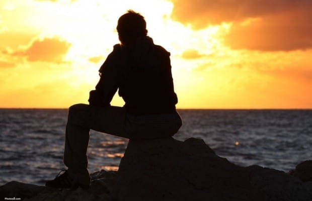 man_sitting_and_watching_sunset-other